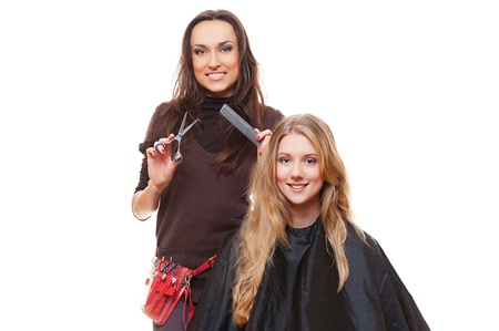 studio shot of hairdresser and young woman. isolated on white photo