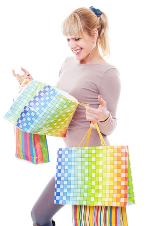 studio shot of young woman after shopping. isolated on white photo