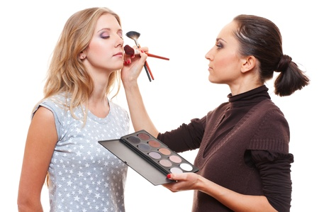 esthetician: make up artist with beautiful model isolated on white Stock Photo