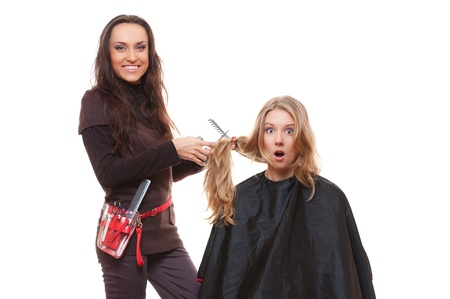 shorten: shocked client and hairdresser. isolated on white