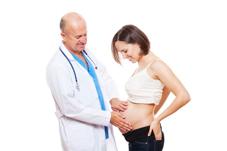studio shot of smiley pregnant woman and doctor. isolated on white photo