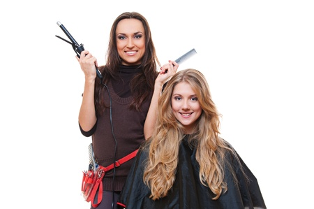 studio shot of hairdresser and blonde woman. isolated on white photo