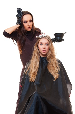 shorten: studio shot of hairdresser and shocked client. isolated on white Stock Photo