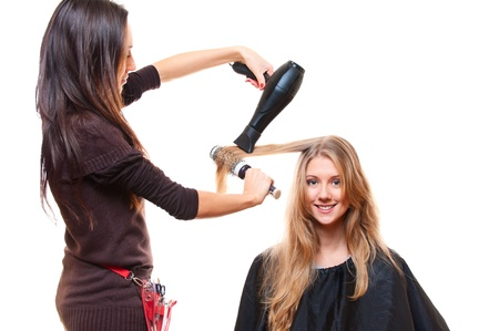 studio shot of hairdresser with hairdryer. isolated on white photo