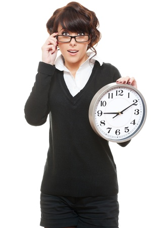 studio shot of woman in glasses with clock. isolated on white photo