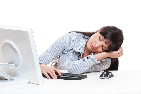 tedium: young secretary sleeping on her workplace. isolated on white