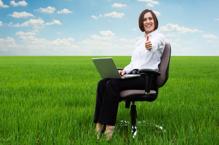 recliner: bright picture of smiley secretary on the field showing thumbs up