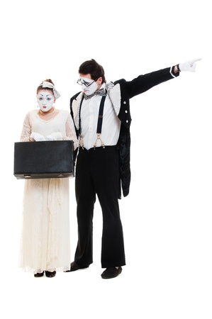 make love: studio shot of mimes with suitcase  isolated on white