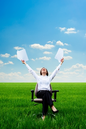 young smiley woman with documents at the meadow Stock Photo - 13723119