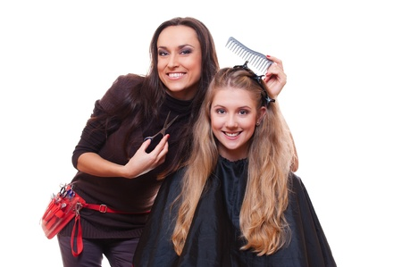 young hairdresser and young woman  studio shot over white background Stock Photo - 13723112