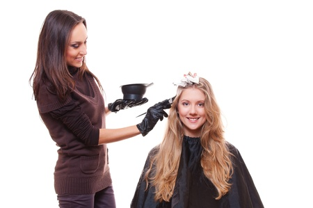 young stylist and blonde woman  studio picture over white background photo