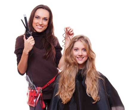 studio shot of hairdresser doing curly hair. isolated on white background Stock Photo - 13911771