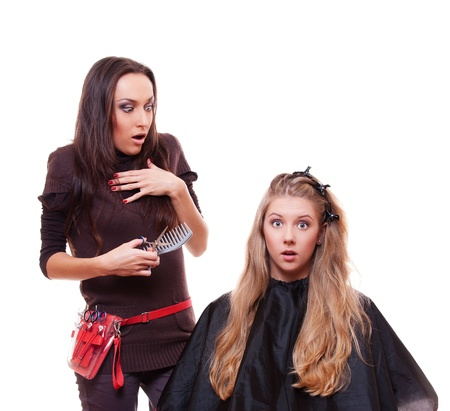 studio shot of shocked hairdresser and client isolated on white background photo