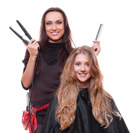 supercharger: studio shot of smiley hairdresser with straighteners over white background