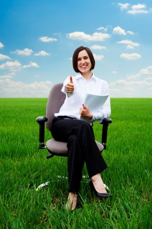 hurl: smiley businesswoman with documents showing thumbs up at the field