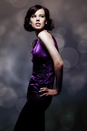 studio shot of glamor woman over dark blurred background photo