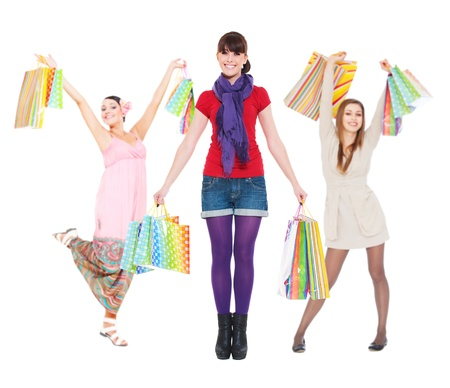 young women with shopping bags against white background  photo