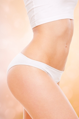 healthy womans body in white underwear photo