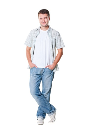 young man posing at studio over white background photo