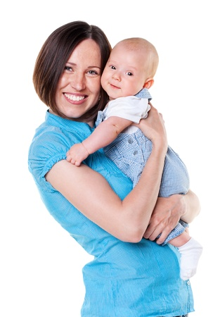 mom holding baby: smiling mother holding her baby. isolated on white background