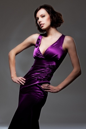 attractive woman in violet evening gown  photo
