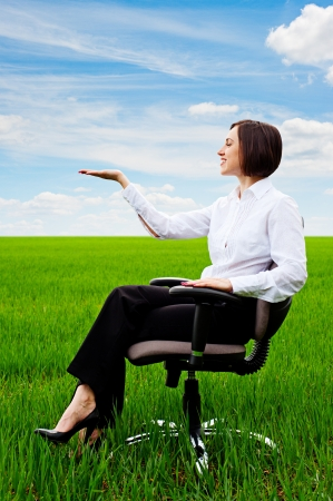 recliner: beautiful businesswoman sitting on recliner and holding something on her hand