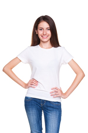 alluring: alluring young woman in white t-shirt and blue jeans posing over white background Stock Photo