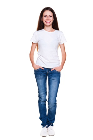 young youth: portrait of happy teenager in white t-shirt and jeans. isolated on white background Stock Photo