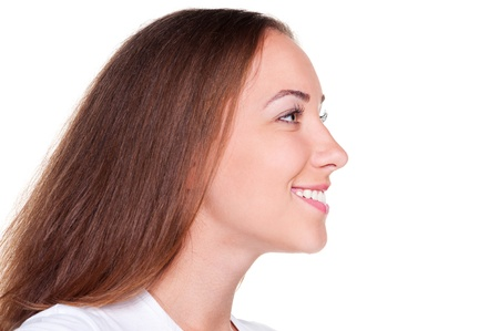 side profile: side view of beautiful woman with long hair over white background