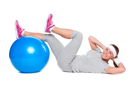 fitness woman doing exercises for abdominal muscles with ball. isolated on white background photo