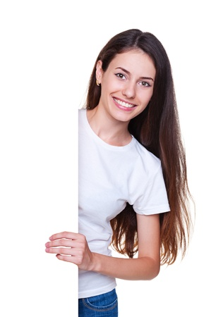 alluring: alluring young woman standing near empty board Stock Photo