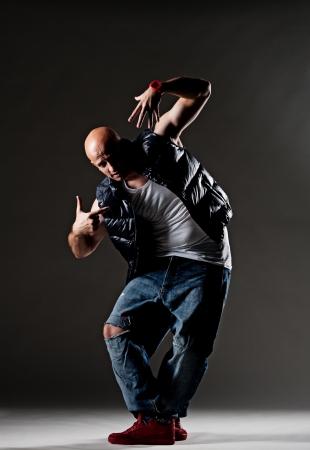 male dancer: cool hip-hop dancer over dark background