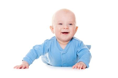 crawl: happy little baby lying on white floor