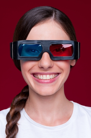 smiley woman in stereo glasses over red background Stock Photo - 14748858