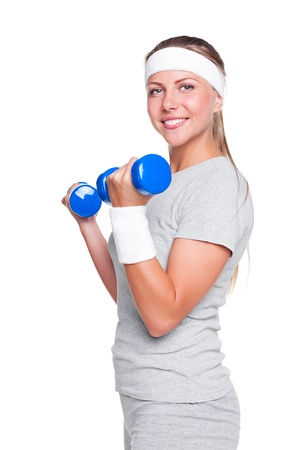 woman posing with blue dumbbells and smiling. studio shot over white background Stock Photo - 14748867