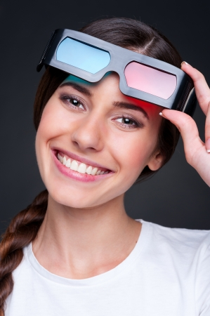 cheerful young woman with stereo glasses over dark background Stock Photo - 14748872