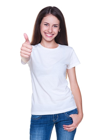 young positive woman showing thumbs up and smiling. isolated on white background Stock Photo - 14748854