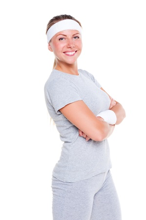 young woman in sportswear posing and smiling. isolated on white background Stock Photo - 14748848