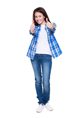 beautiful girl showing thumbs up and smiling. isolated on white background Stock Photo - 14936373
