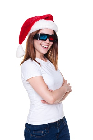 holiday blockbuster: cheerful girl in santa hat and 3d glasses posing over white background