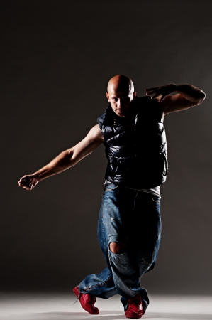 modern dancer posing in studio over dark background Stock Photo