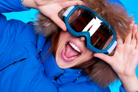 emotional woman: happy emotional woman in ski glasses and winter coat