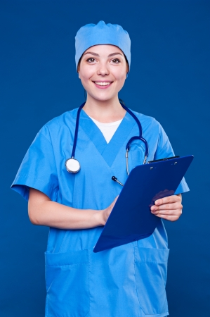community health: friendly community health worker over blue background  Stock Photo