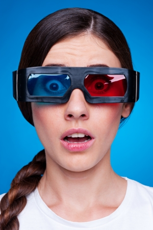 blockbuster: woman watching 3d film in stereo glasses