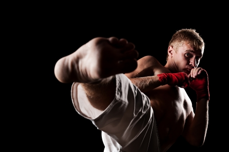 kickboxing: studio portrait of fighter over black background