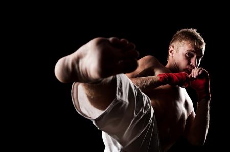 pugilist: studio portrait of fighter over black background