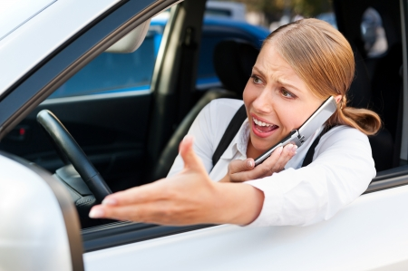 motorist: young angry woman in traffic jam