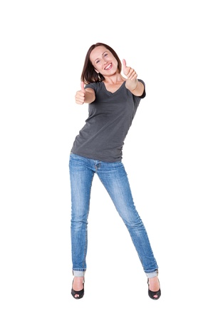 full length portrait of excited young woman showing thumbs up over white background Stock Photo - 15708099