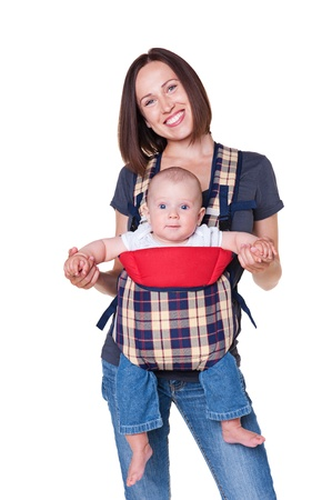 slings: pretty little baby sitting in the sling, smiley woman holding his. isolated on white background