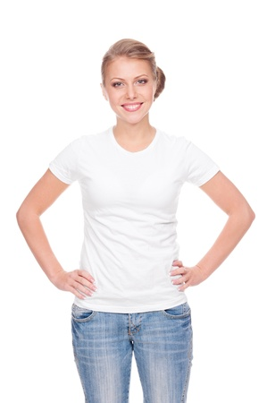 t shirt: alluring young woman in the white t-shirt and blue jeans standing over white background